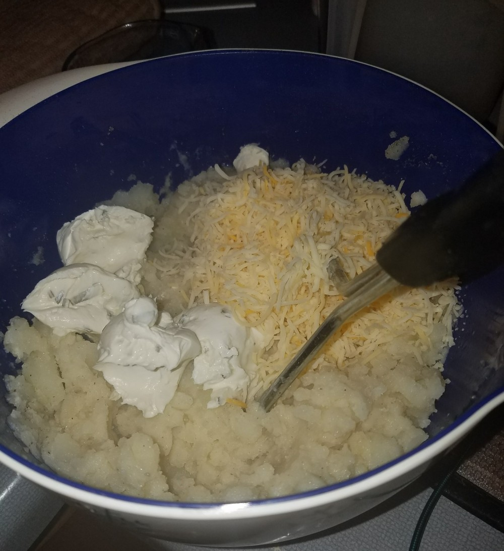 potatoes with ingredients before filling